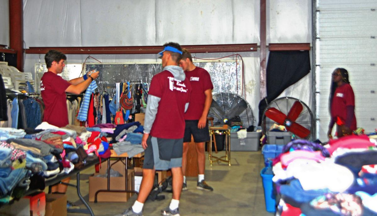 College students get 'oriented' by helping at Lowville food pantry event