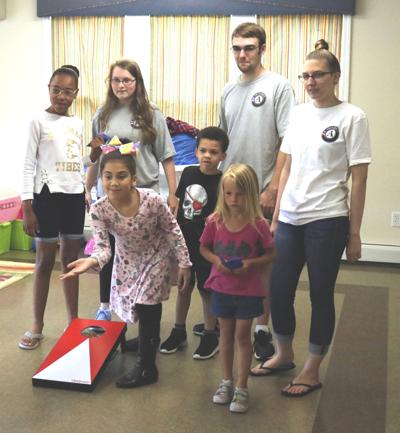AmeriCorps members assist OCO's Summer Food Service Program