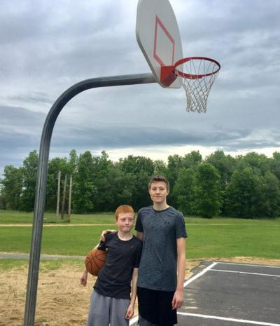 Boys' efforts lead to basketball court upgrade