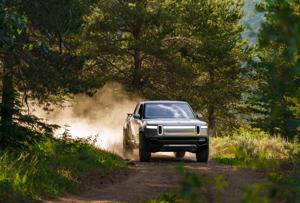 Group of Illinois auto dealers sue the state and Rivian EV startup.
