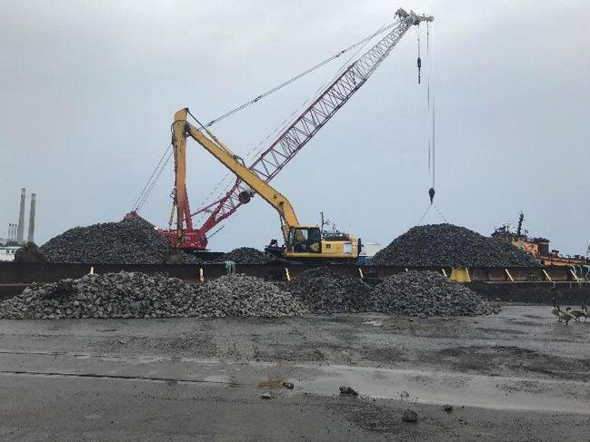 Corps of Engineers began construction on the Oswego Harbor west arrowhead breakwater
