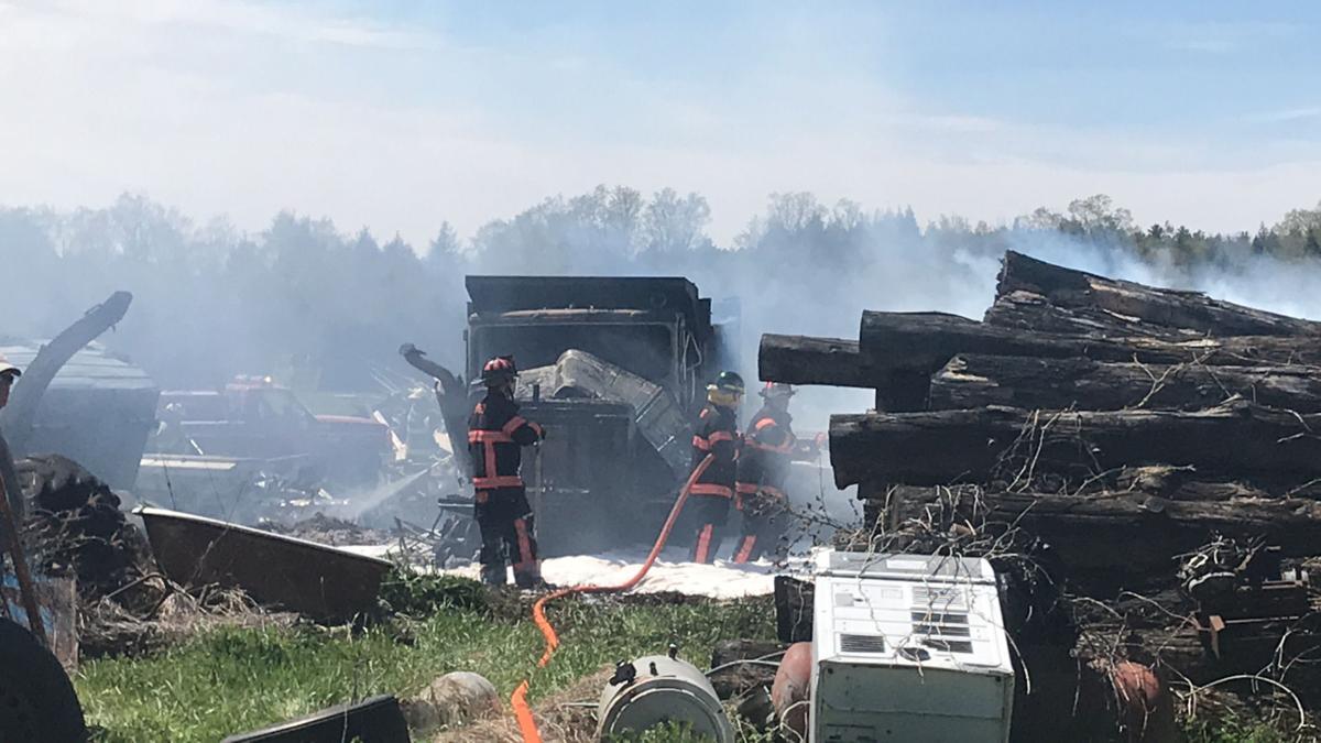 Norwood grass fire spreads, burns truck, car
