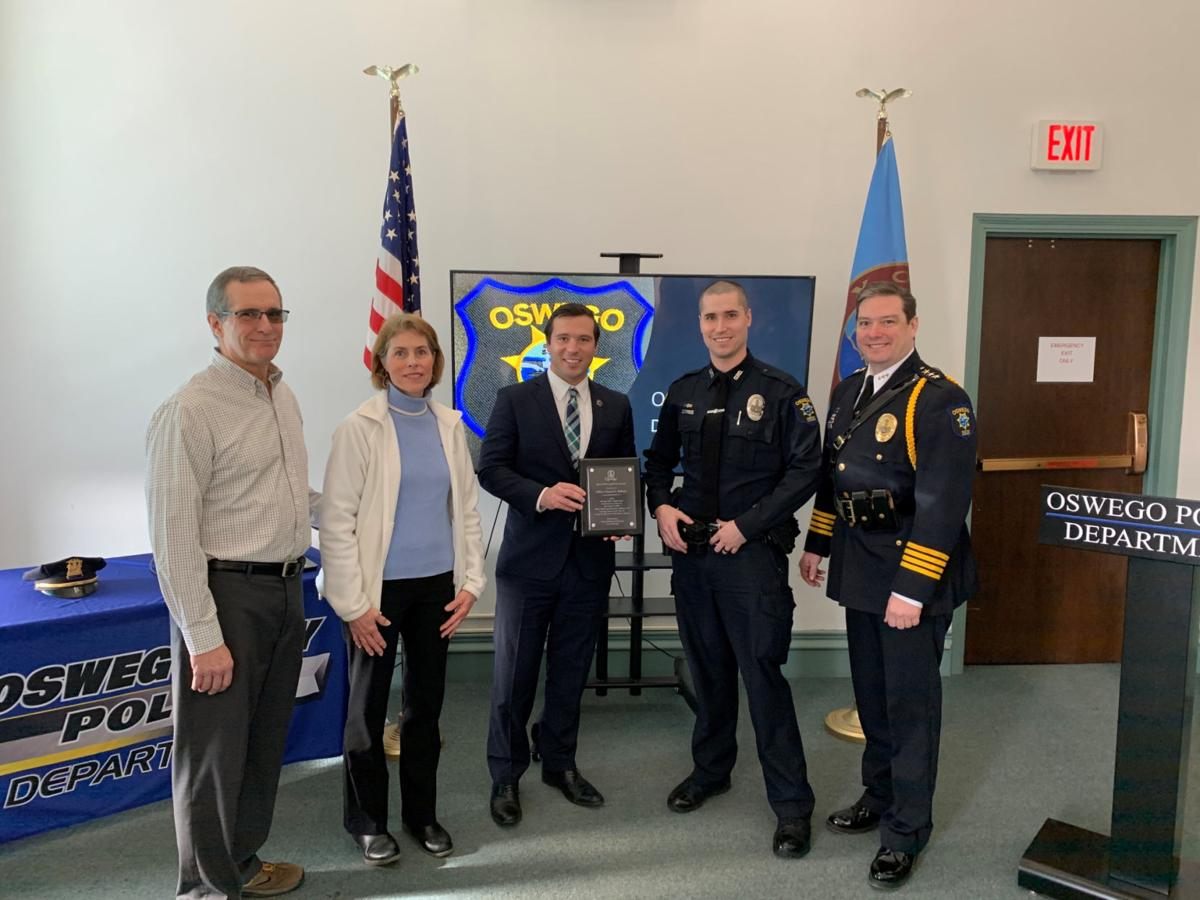 Officer Balloni honored for role in rescuing woman from the Oswego River