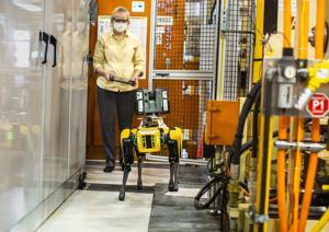 Ford trains robotic dog to map its plants.