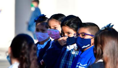 Schools carry on as virus spikes