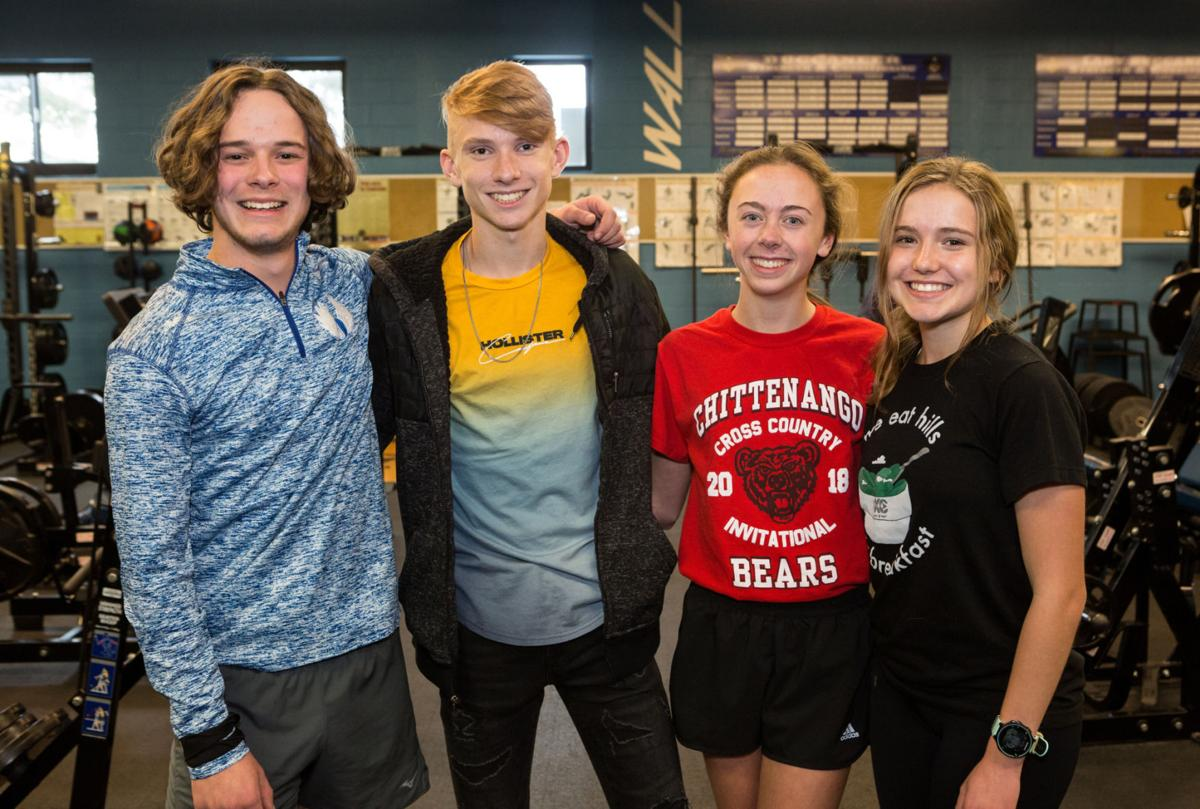 Oswego cross country teams give back