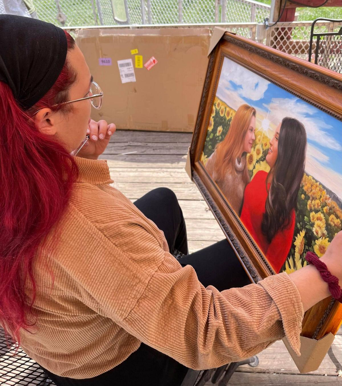 Paintings memorialize teen found lying on city riverwalk