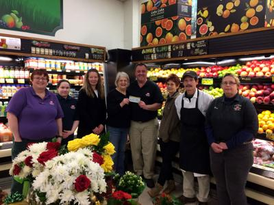IGA raises $3,010 for Potsdam Holiday Fund through sale of 'happiness' tags