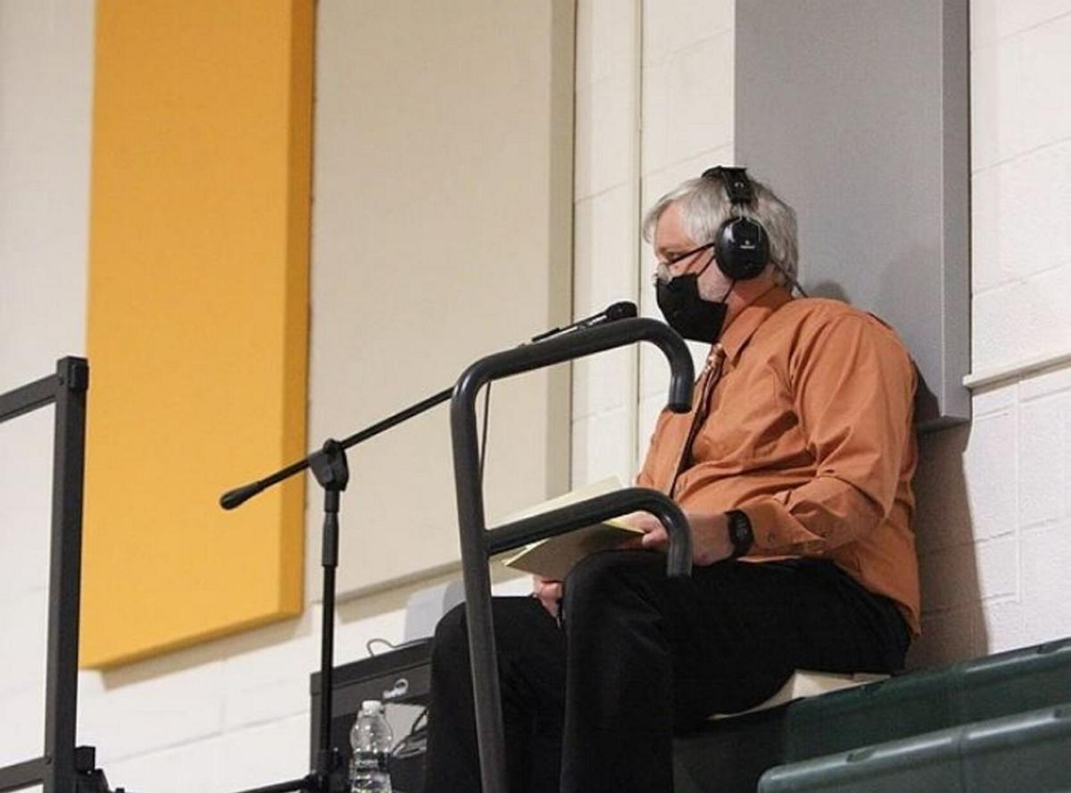 School administrator provides play-by-play at hoops games