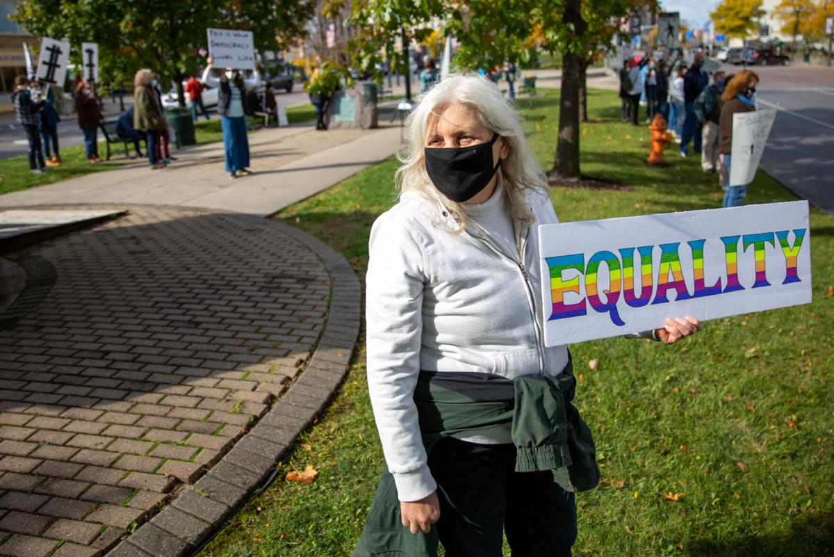 Trio of friends stress equality, unity in Public Square rally