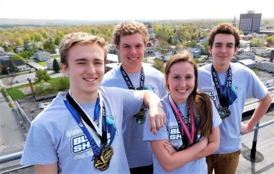 Swim team members to rappel for charity