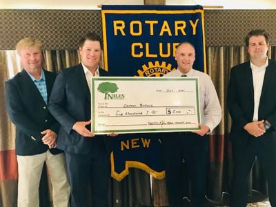 Niles Asset Management donates $5,000 to Canton rotary