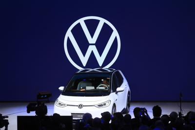 VW unveils new logo, affordable e-cars