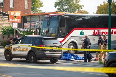 Pedestrian killed in bus incident
