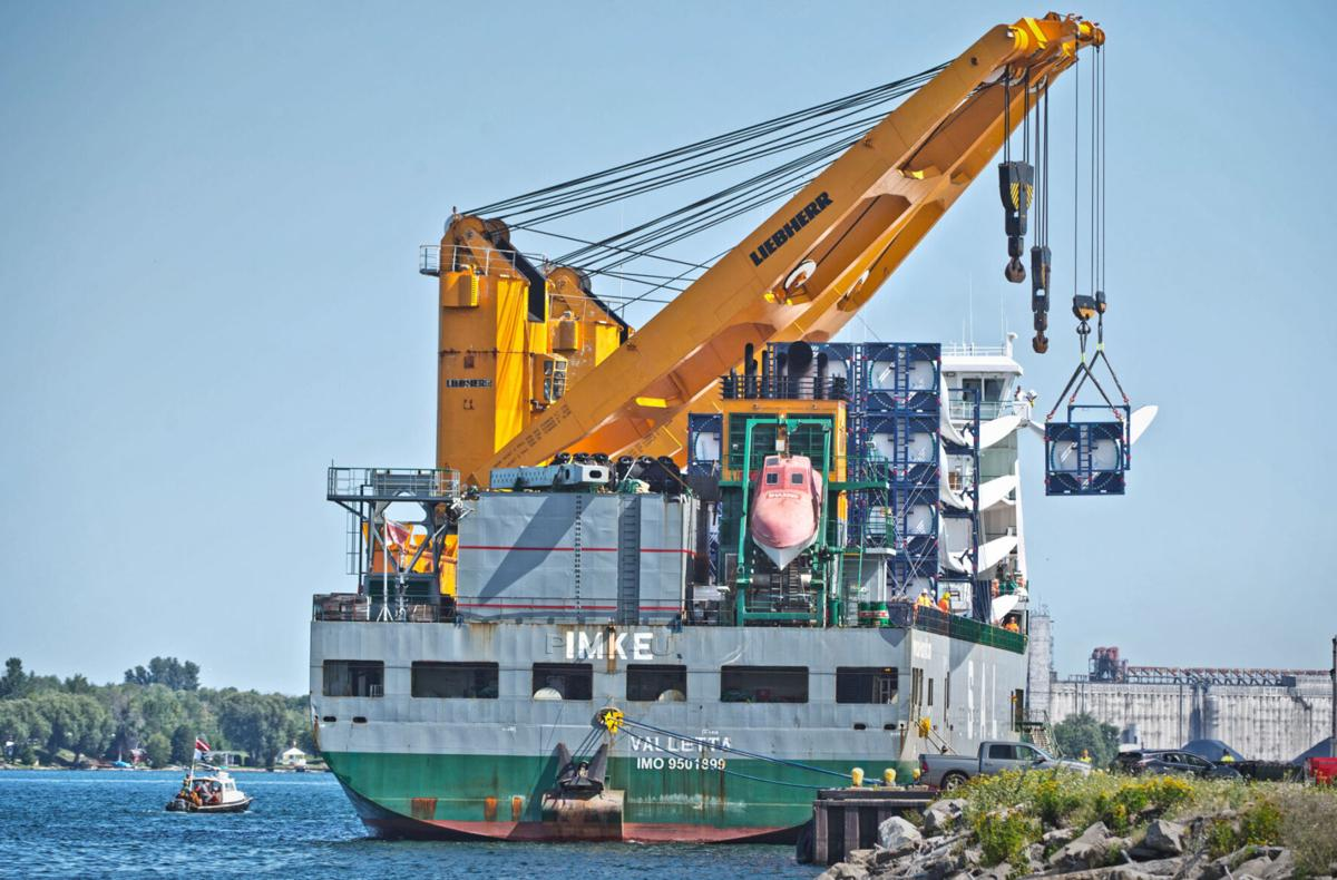 Freed ship finally unloads cargo
