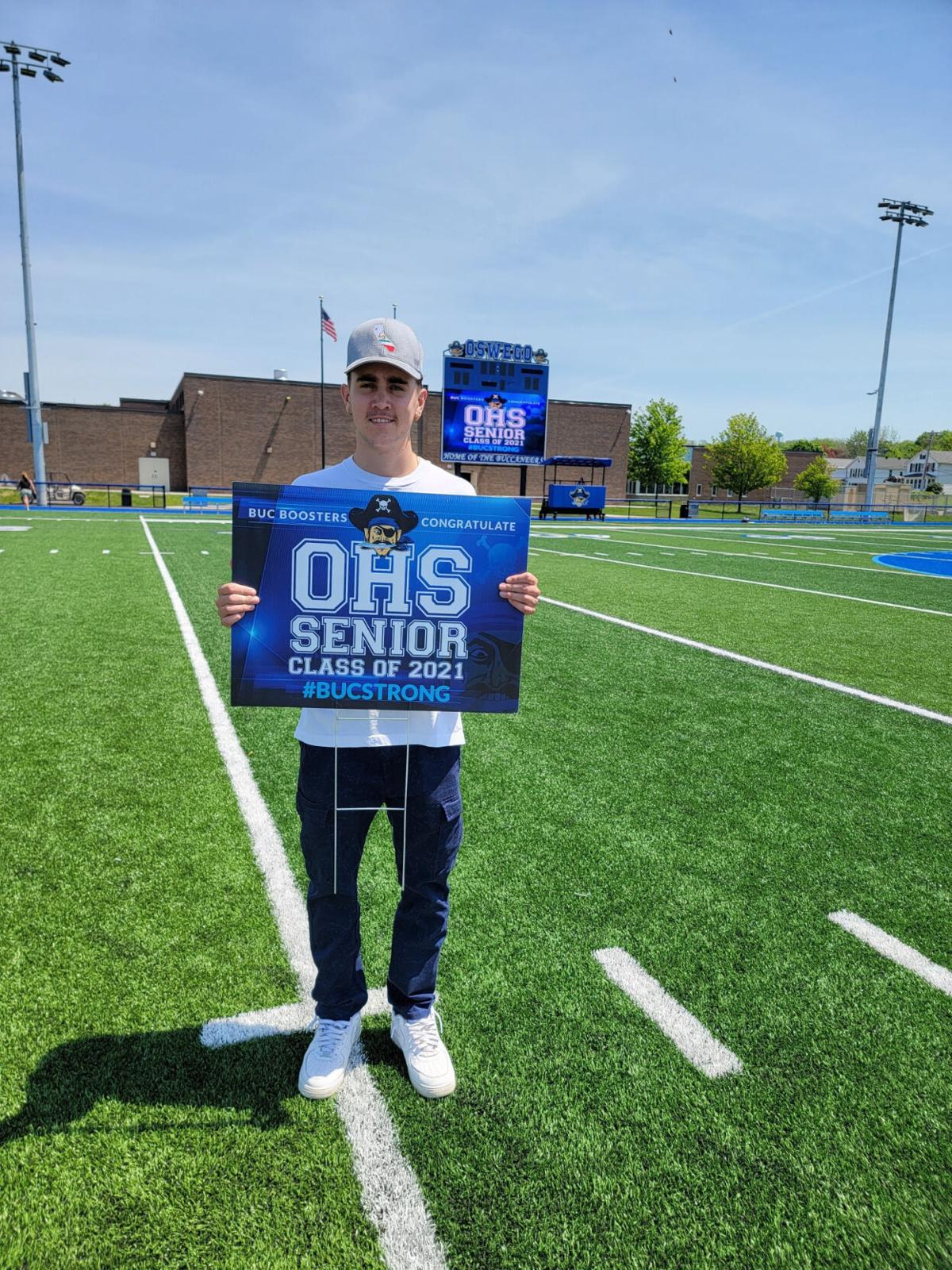 Buc Boosters support Oswego High School seniors with yard signs
