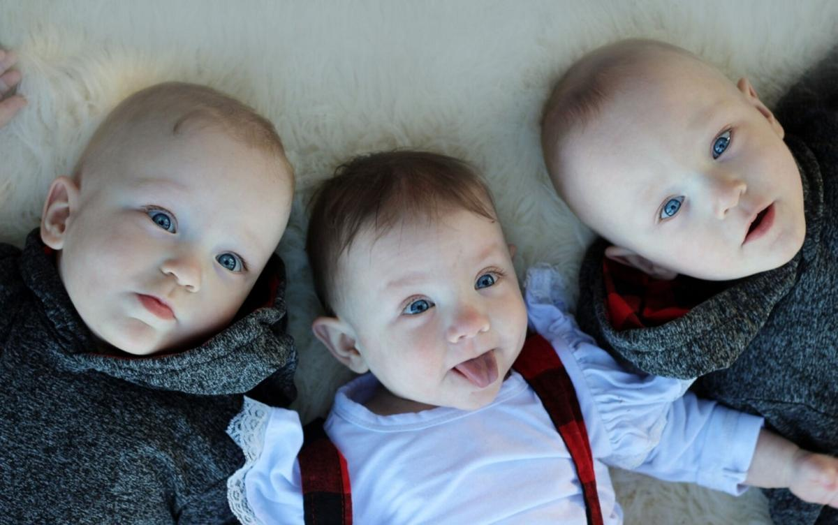 Triplets mark year of overcoming odds