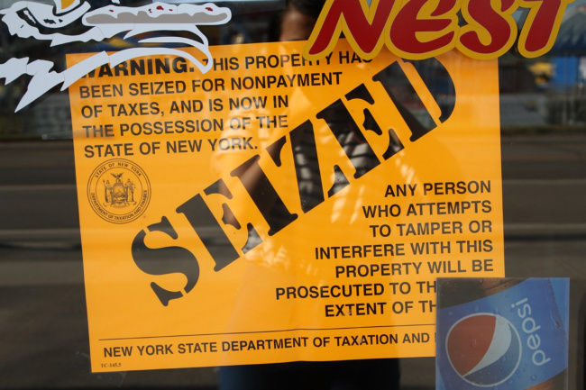 Malone businesses seized for nonpayment of taxes