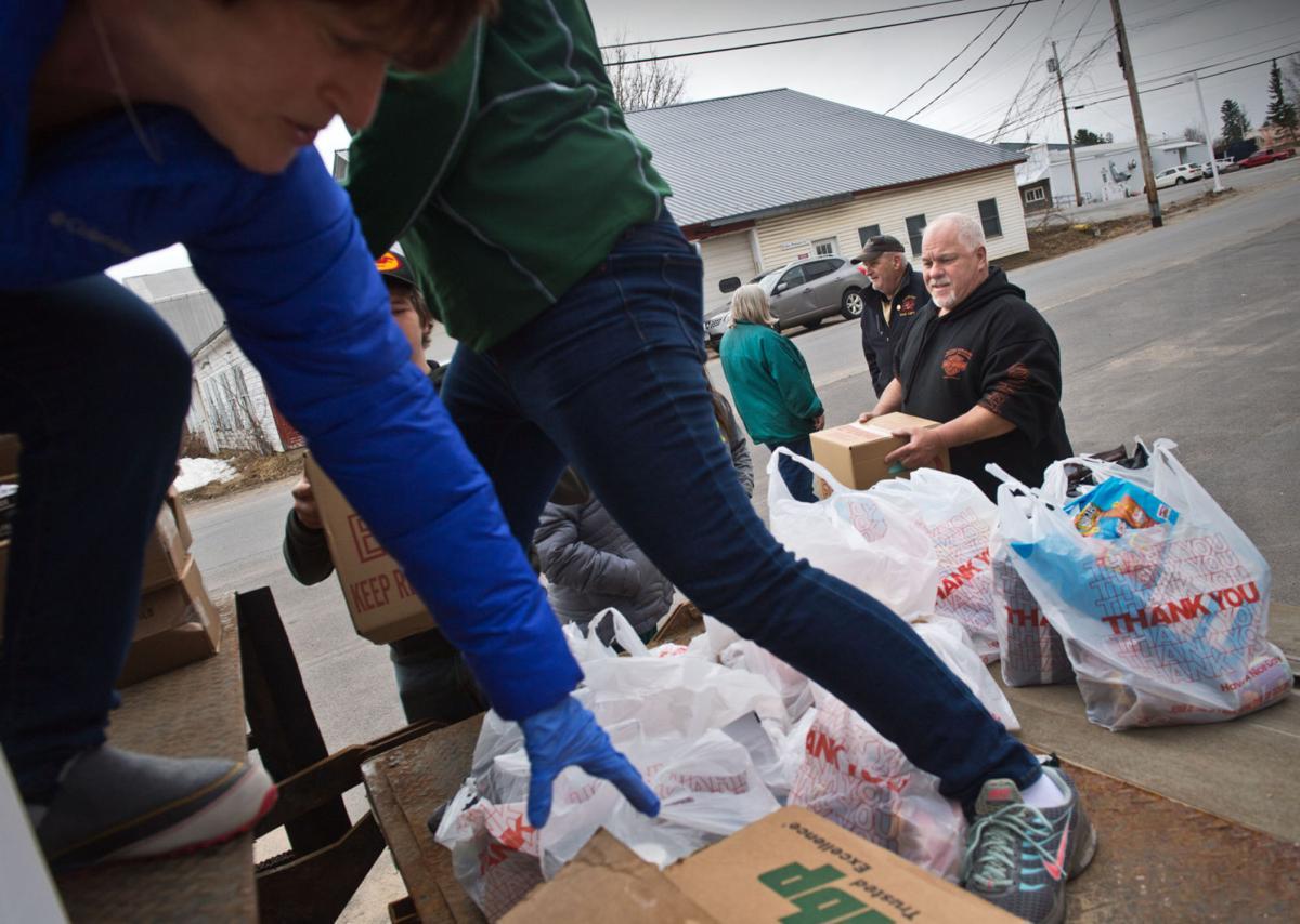 Norwood retailer gives away food