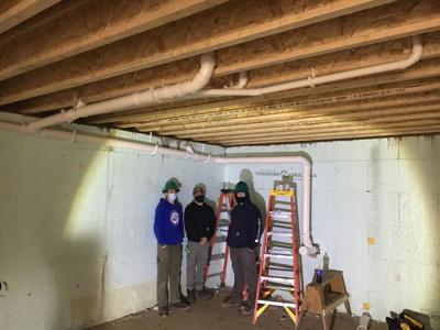 HVAC students assist Allegany County Land Bank with plumbing work