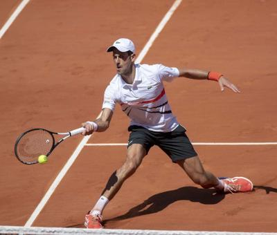Djokovic glides to quarters