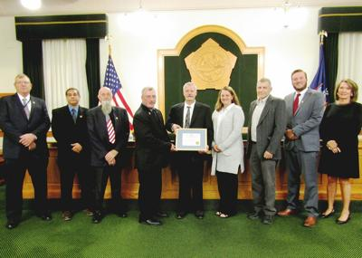 Vrooman receives certificate of appreciation at retirement