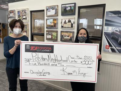 TJ Toyota gives to potsdam Neighborhood Center