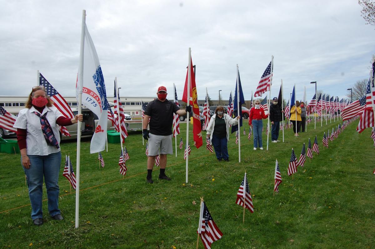 Volunteers set up Carthage Memorial Day display