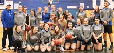 OHS girls JV, varsity basketball teams provide holiday help