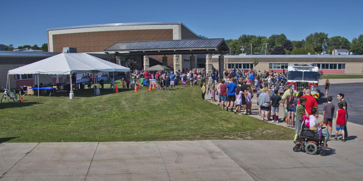Students prepare for new school year at Massena event