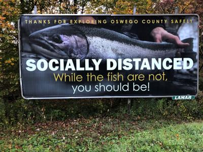 Oswego County Tourism Departments installs social distance billboards with special message to anglers