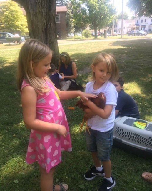 Proud kids present pets in library show-and-tell