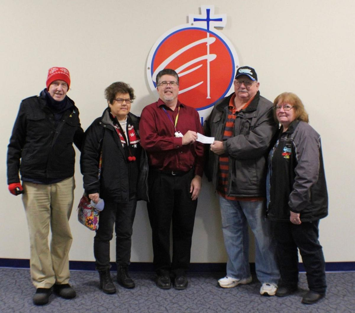 Country Cruisers, Fulton Fire Department donate to Catholic Charities