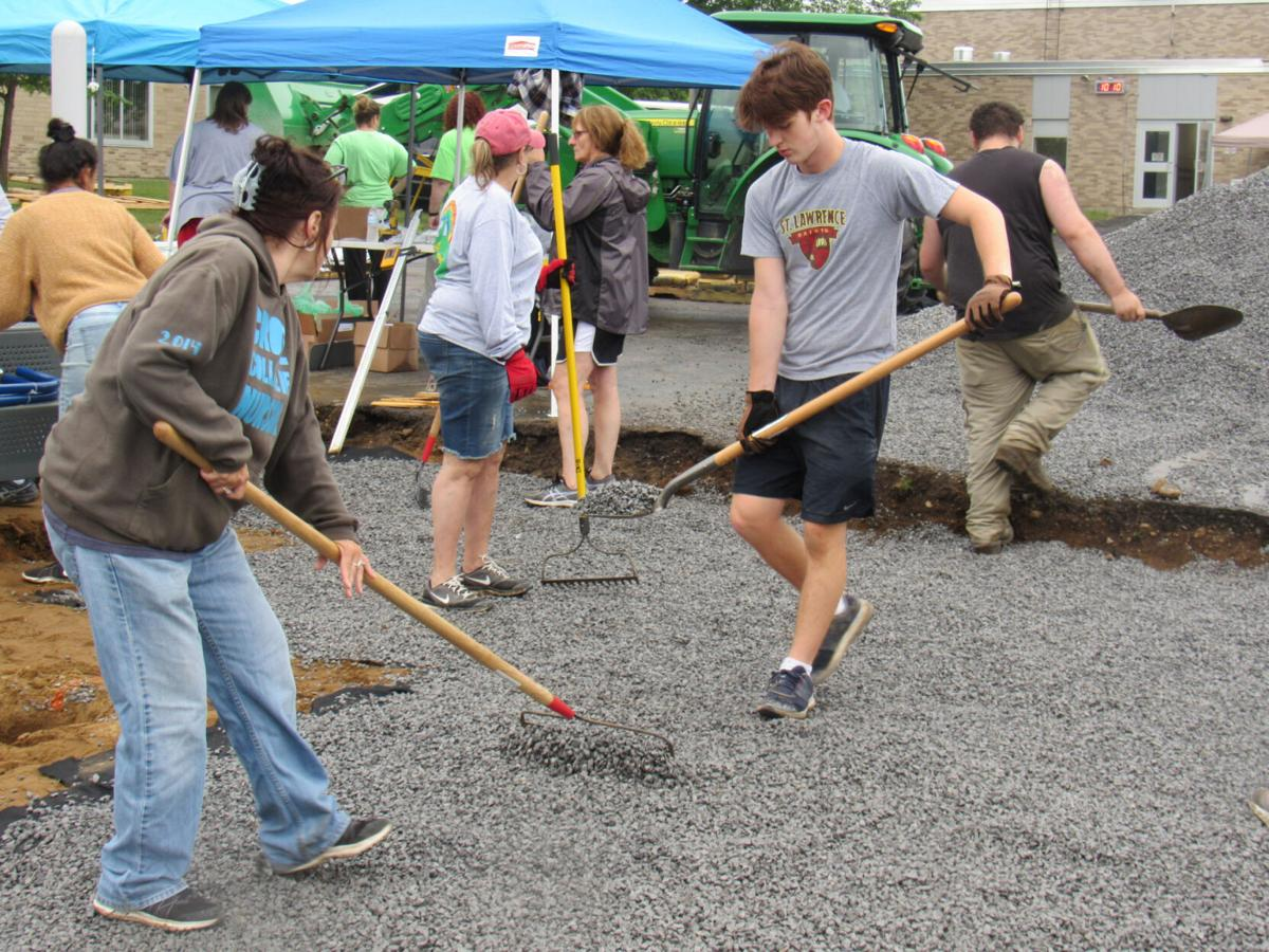 Volunteers work to build new playground