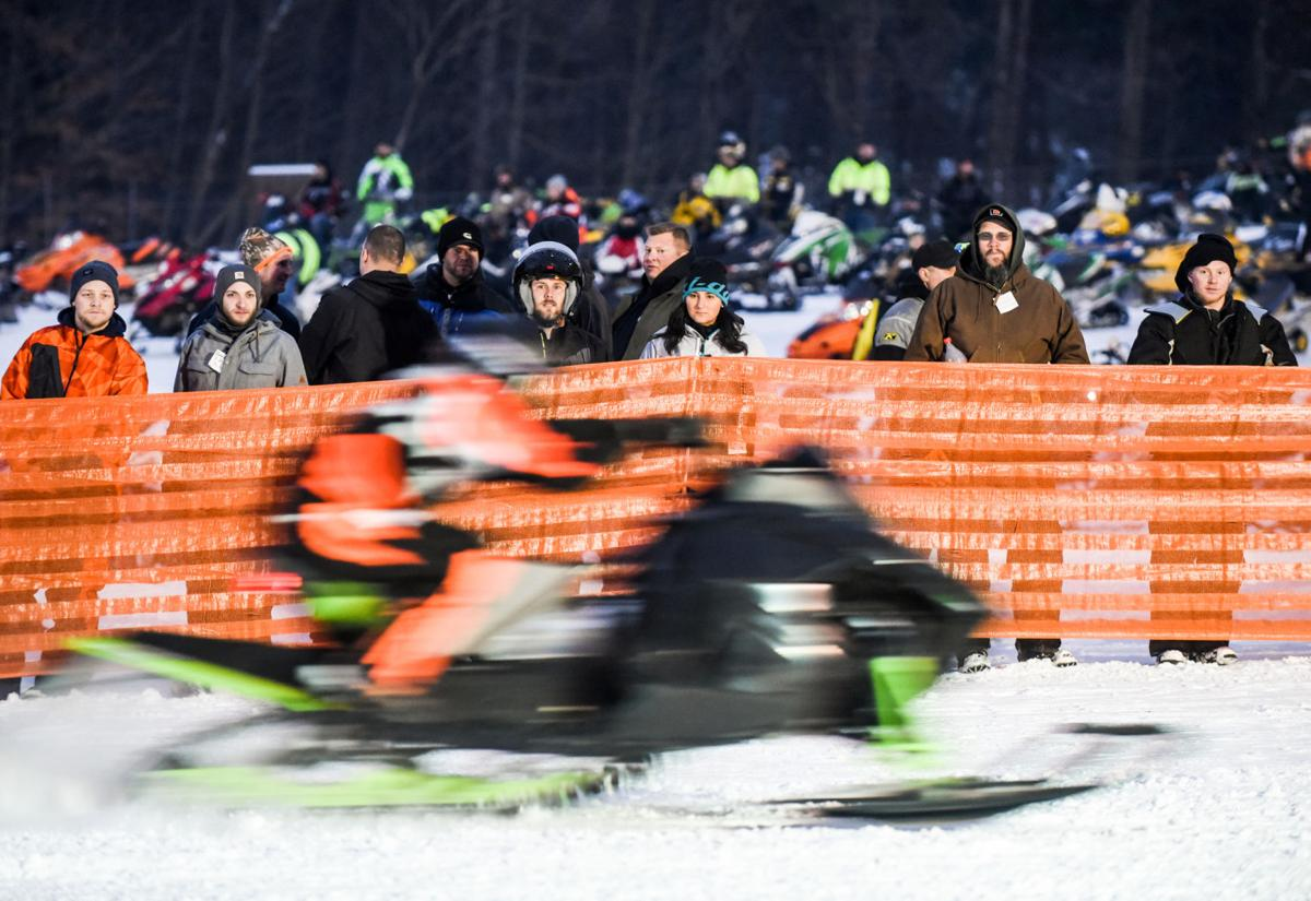 Hundreds turn out for snowmobile drag racing event NO SNOW