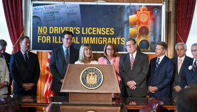 License bill edges into law