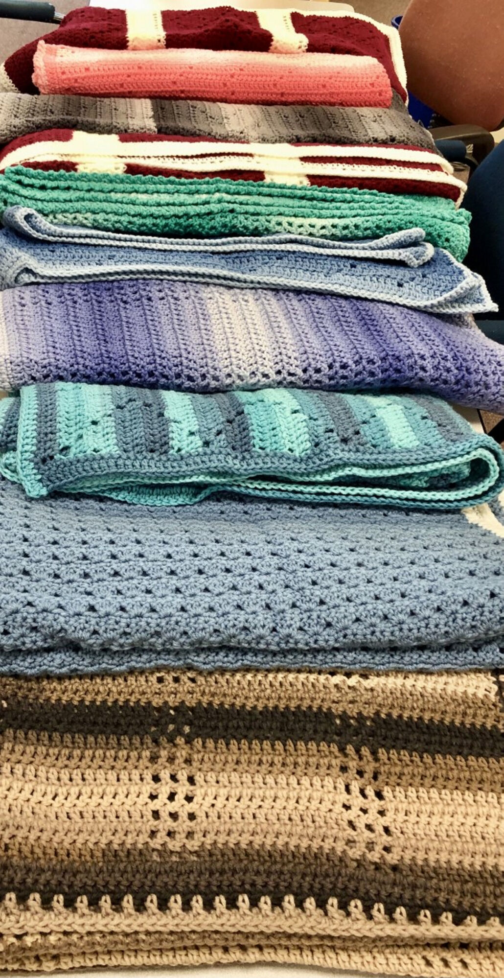 Alm donates 'lapghans' to Friends Of Oswego County Hospice