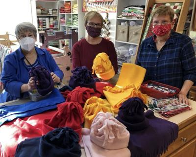 Children's Board donates hats and scarves