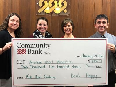 Community bank gives to AHA