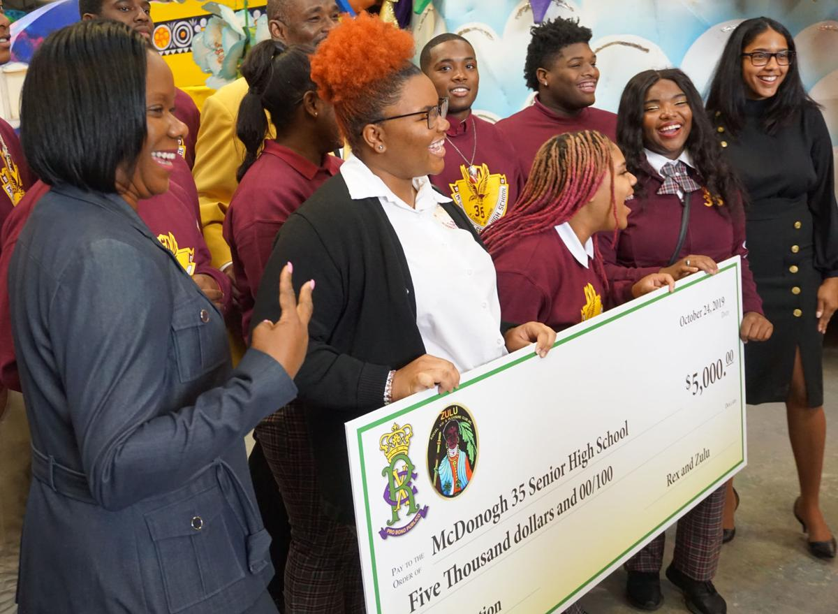 Students of the McDonogh 35 College Preparatory High School accept a donation from Rex and Zulu Mardi Gras krewes STAFF PHOTO BE DOUG MacCASH.jpg