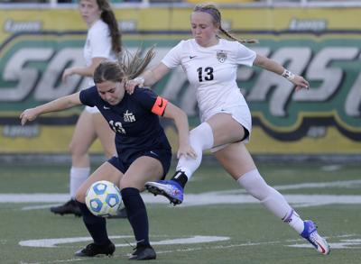 Lakeshore's Megan Gettys battles with STM's Riley LeBlanc