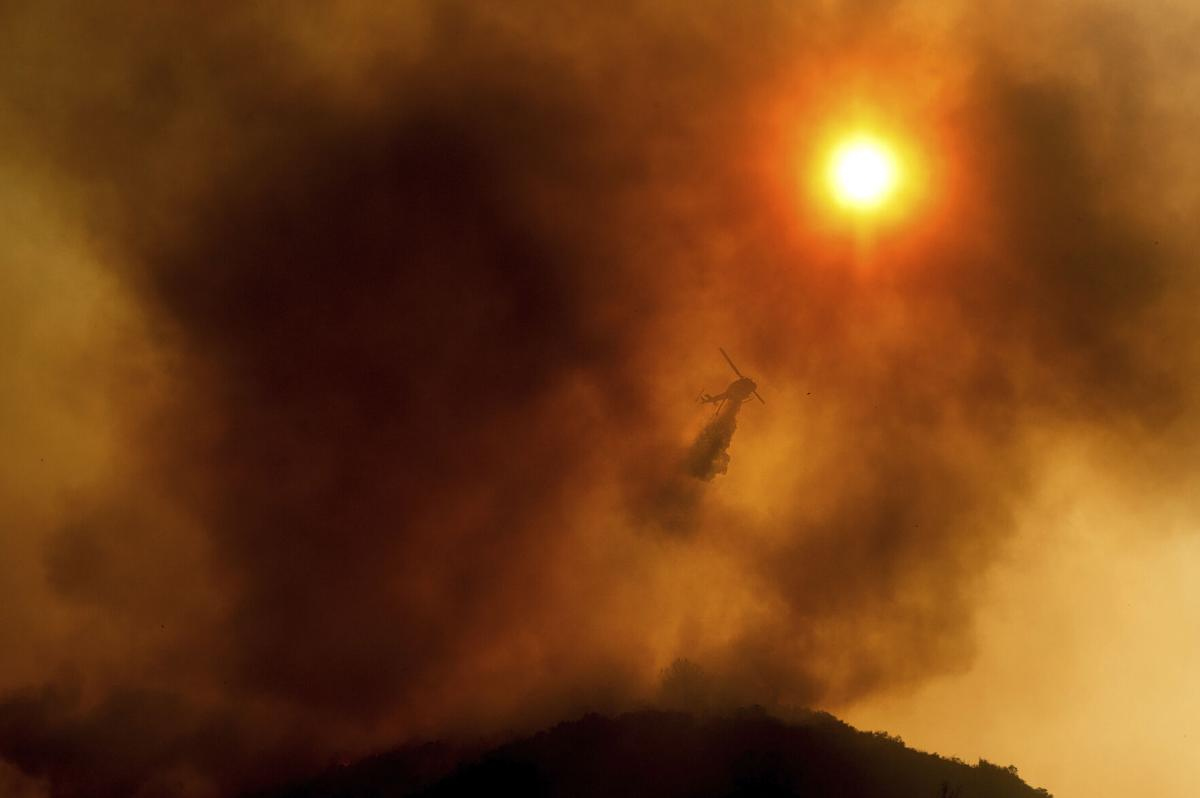 Helicopter over wildfire in Salinas, California