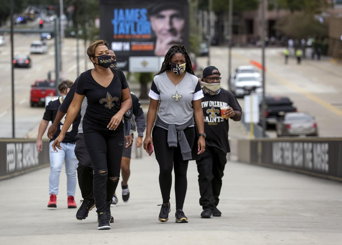 Saints fans in masks