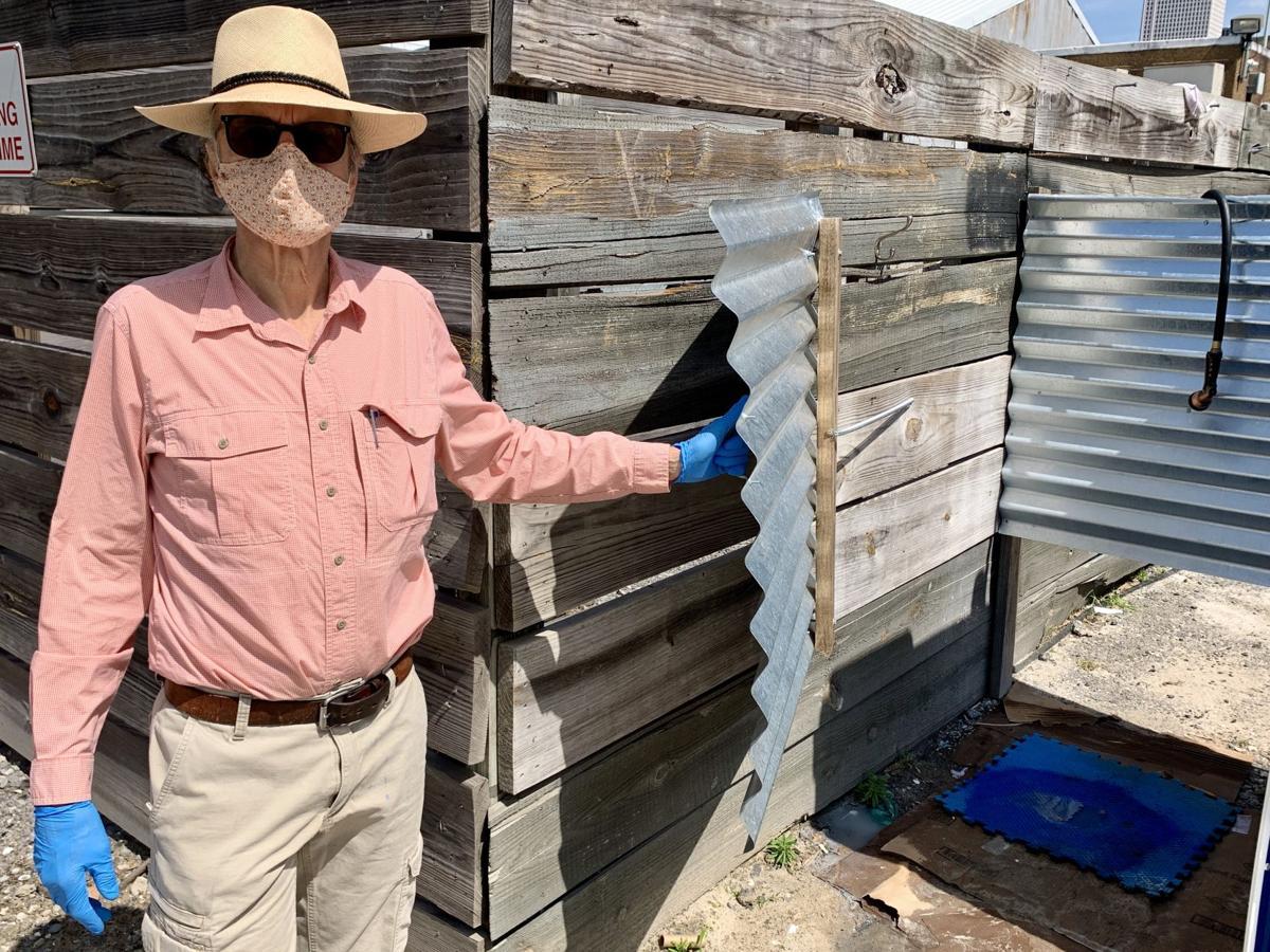 Artist-designer William Monaghan displays his coronavirus-era homeless shower stall