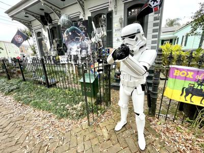 Mardi Gras house float - Stormtrooper Mike Wolanski playfully aims a blaster at passersby on Mardi Gras 2021.jpeg