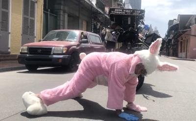 Street performer Mamie Marie Francois triumphantly twerks on Bourbon Street on Good Friday