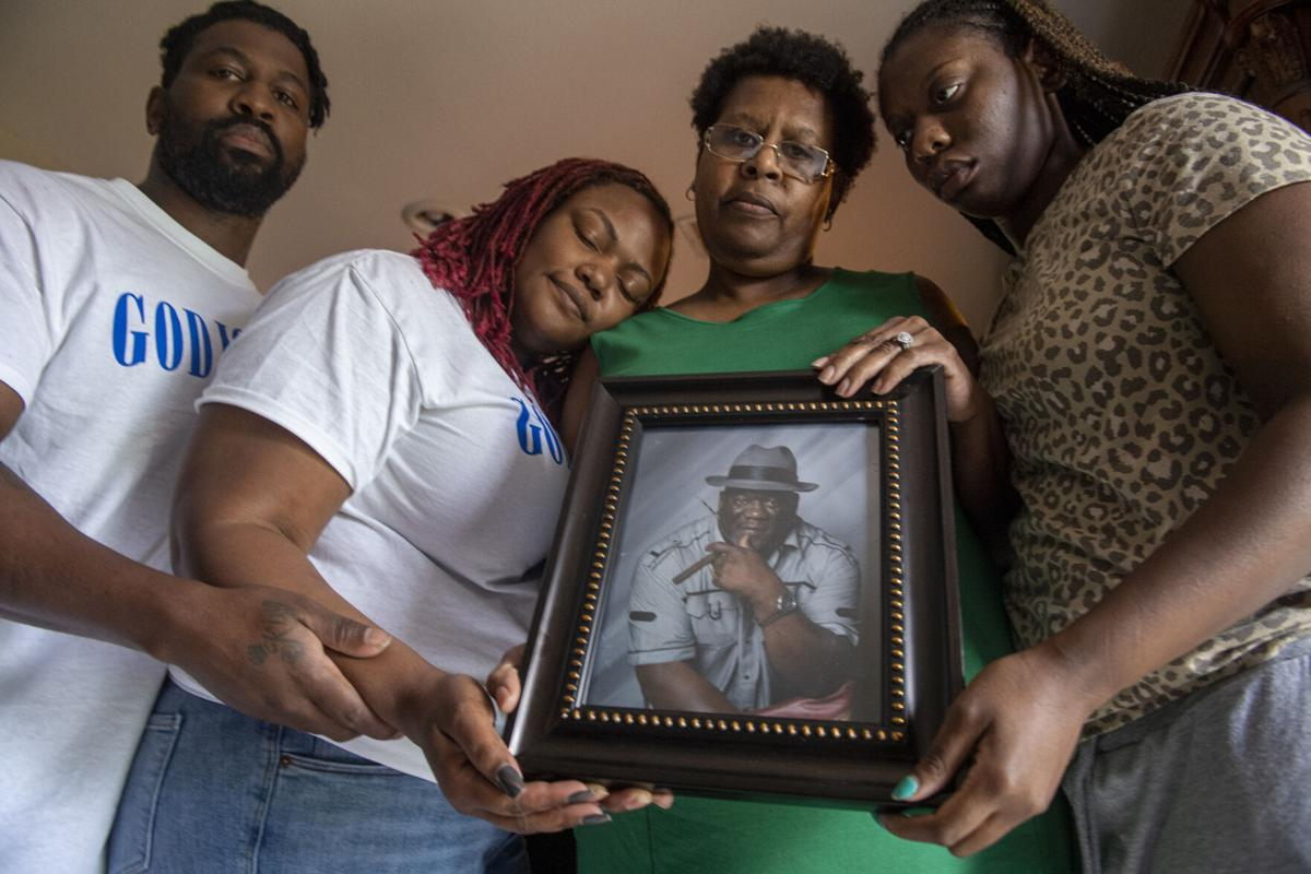 Family surrounds picture of Anthony Hardtford, who died during the Seacor Power disaster
