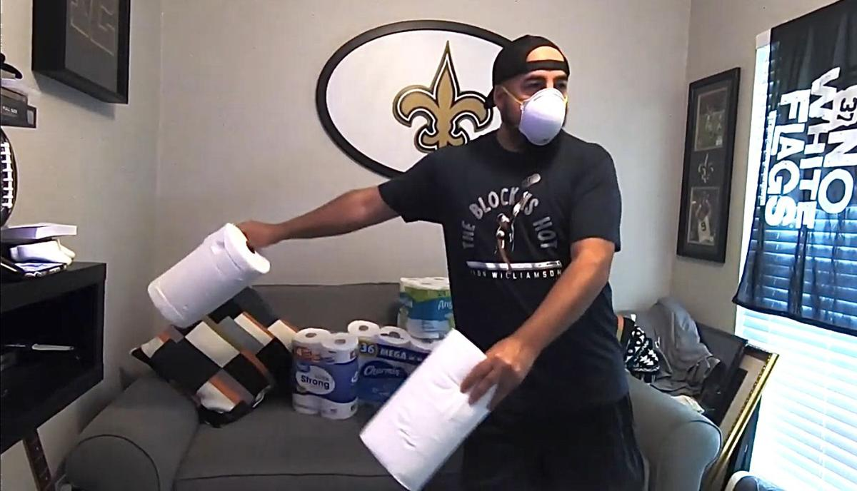Ben Collier combats stir-craziness by doing 'The Floss' in a surgical mask.