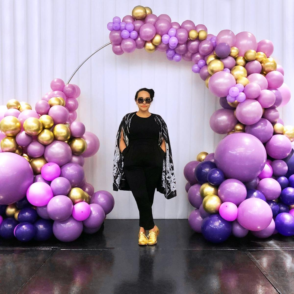Ontiveros in front of balloon installation