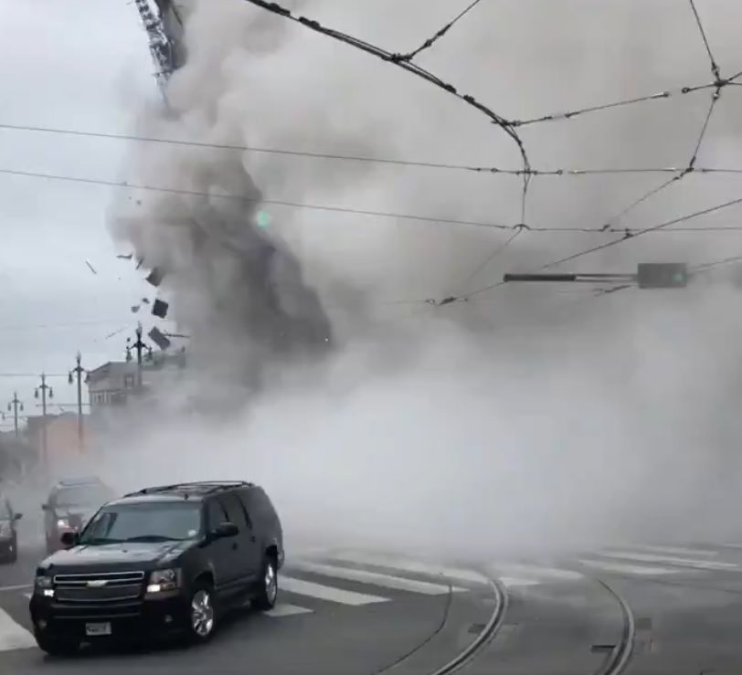 Streetcar and vehicles near collapse of Hard Rock Hotel in New Orleans